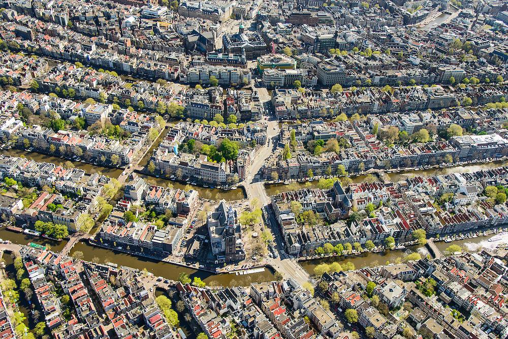 Nederland, Noord-Holland, Amsterdam, 09-04-2014;<br /> Binnenstad en grachtengordel, vbnb Prinsengracht, Keizersgracht, Herengracht, Singel doorsneden door de Raadhuisstraat.<br /> Aan de Prinsengracht Anne Frankhuis, Westertoren, Westermarkt.<br /> Bovenmidden de Dam met het Paleis op de Dam, de Nieuwe Kerk.<br /> Center and ring of canals of Amsterdam. <br /> The Westerkerk (church) next  to the Achterhuis (now Anne Frank House)  where people are queueing.<br /> luchtfoto (toeslag op standard tarieven);<br /> aerial photo (additional fee required);<br /> copyright foto/photo Siebe Swart