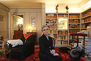 Portrait of Catherine Robbe-Grillet in the salon of her Paris apartment. A whip and stole lie on the kneeling chair behind...Catherine Robbe-Grillet, born in 1930 (nee Rstakian) is a french writer, former photographer, theatre and film actress who is well known for her writings and practice of BDSM or Bondage, Discipline, Sadism, Masochism. She wrote under the pseudonyms of Jean de Berg and Jeanne de Berg. She was renowned for her organisation of BDSM sessions for interested parties in high Parisian society, where she took on different roles. She had a very free and open loving relationship with her husband Alain Robbe-Grillet whom she married in 1957 (he died in 2008) with whom they recounted their adventures to each other...Her publications include L'image par Jean de Berg. Paris: Éditions de Minuit, 1956, Cérémonies de Femmes by Jeanne de Berg. Paris: Éditions Grasset 1985, Entretien avec Jeanne de Berg by Catherine Robbe-Grillet. Paris: Éditions les Impressions Nouvelles 2002, Jeune mariée: journal, 1957-1962 by Catherine Robbe-Grillet. Paris: Fayard 2004, Le Petit carnet perdu par Jeanne de Berg. Paris: Fayard 2007.