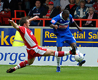Photo: Ed Godden.<br />Swindon Town v Stockport County. Coca Cola League 2. 26/08/2006. Paul Evans (L) challenges Stockport's Michael Malcolm.