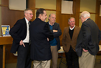 Laconia's current Mayor Edward Engler talks with the city's past Mayors Matt Lahey, Paul Fitzgerald, Karl Reitz and Rod Dyer at the Laconia Mayors Symposium Tuesday evening at the Laconia Public Library.  (Karen Bobotas/for the Laconia Daily Sun)