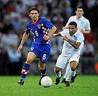 Danijel Pranjic<br /> Croatia 2009/10<br /> Aaron Lennon England<br /> England V Croatia (5-1) 09/09/09 <br /> World Cup Qualifier 2010 at Wembley Stadium<br /> Photo Robin Parker Fotosports International