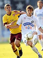 Fotball<br /> 21.07.2010<br /> Foto: Gepa/Digitalsport<br /> NORWAY ONLY<br /> <br /> SK Sturm Graz vs Arsenal FC<br /> <br /> Bild zeigt Jack Wilshere (Arsenal) und Stefan Stangl (Sturm)