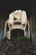 A woman explores an abandoned school, built in the early 1900s, in Shushi, Nagorno-Karabakh. Fighting raged in the region in the late 1980s and early 1990s, and in 1991 Nagorno-Karabakh broke away from Azerbaijan, declaring independence. Internationally, however, it is still recognized as part of Azerbaijan.<br /> <br /> (September 23, 2016)