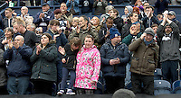 Preston North End fans wait to applaud their team as they do a lap of the pitch after their last home league match of the season<br /> <br /> Photographer Stephen White/CameraSport<br /> <br /> Football - The Football League Sky Bet League One - Preston North End v Swindon Town - Saturday 25th April 2015 - Deepdale - Preston<br /> <br /> © CameraSport - 43 Linden Ave. Countesthorpe. Leicester. England. LE8 5PG - Tel: +44 (0) 116 277 4147 - admin@camerasport.com - www.camerasport.com