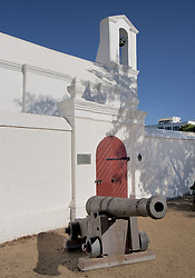 March 19, 2011 - Stellenbosch, Western Cape, South Africa - Seventeenth Century cannon guard the old barrel vaulted VOC Kruithuis. Dating to 1777, it faces The Braak (Village Green) of Stellenbosch. A government fort and armory, unique as the only remaining powder magazine in South Africa from the days of the Dutch East India Company (V.O.C), it is now a museum and National Monument. Stellenbosch, founded in 1679, is the second oldest European settlement in South Africa. A favorite tourist destination, known for its beautiful Cape Dutch architecture, it is a central base for exploring the surrounding renowned Cape Winelands. (Credit Image: © Arnold Drapkin/ZUMAPRESS.com)