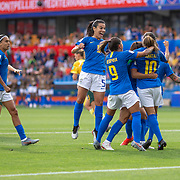 MONTPELLIER, FRANCE June 13.  Marta #10 of Brazil is congratulated by team mates after scoring from the penalty spot during the Australia V Brazil, Group C match at the FIFA Women's World Cup at Stade La Mosson Stadium on June 13th 2019 in Montpellier, France. (Photo by Tim Clayton/Corbis via Getty Images)