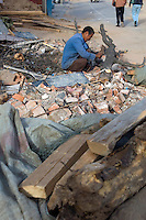 """China, Beijing, Chaoyang, San Jian Fang, 2008. A """"wood man"""" salvages anything he can carry on his pushcart from Chaoyang Street demolition sites.."""