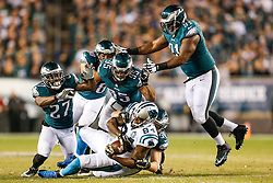 Philadelphia Eagles inside linebacker Casey Matthews #50 tackles the ball carrier with support from other defenders during the NFL game between the Carolina Panthers and the Philadelphia Eagles at Lincoln Financial Field in Philadelphia, Pennsylvania on Monday November 10th 2014. The Eagles won 45-21. (Brian Garfinkel/Philadelphia Eagles)