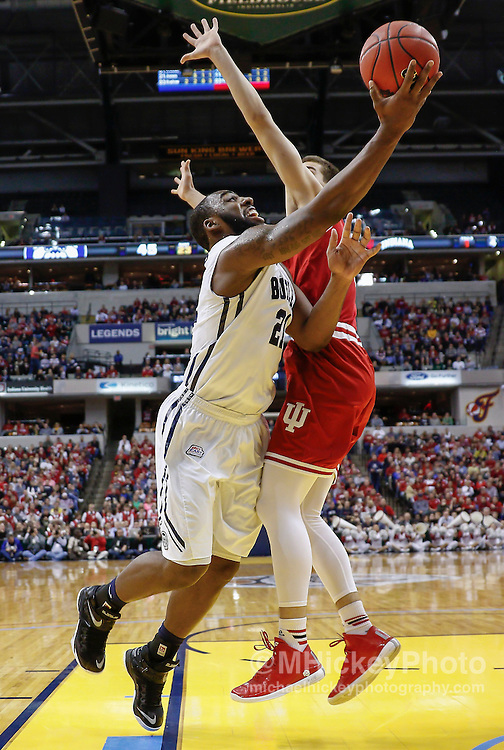 INDIANAPOLIS, IN - DECEMBER  20: Roosevelt Jones #21 of the Butler Bulldogs shoots the ball against Max Hoetzel #3 of the Indiana Hoosiersat Bankers Life Fieldhouse on December 20, 2014 in Indianapolis, Indiana. Indiana defeated Butler 82-73. (Photo by Michael Hickey/Getty Images) *** Local Caption *** Roosevelt Jones; Max Hoetzel