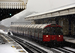 © Licensed to London News Pictures. 18/01/2013. London, UK A Piccadilly Line tube train passes through Turnham Green station in the snow. Snow in West London today 18th January 2013. Photo credit : Stephen Simpson/LNP