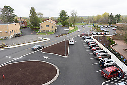 Yale-New Haven Health Park Avenue Medical Center. Architect: Shepley Bulfinch. Contractor: Gilbane Building Company, Glastonbury, CT. James R Anderson Photography, New Haven CT photog.com. Date of Photograph 4 May 2016  Submission 25  © James R Anderson. West Parking Lot and Street View.