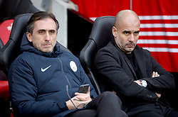 Manchester City manager Pep Guardiola (right) and Head of Player Support and Protocol Manel Estiarte prior to the beginning of the Premier League match at St Mary's Stadium, Southampton.