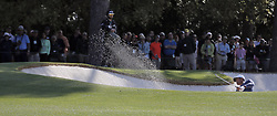 April 6, 2018 - Augusta, GA, USA - Tony Finau hits his second shot out of the fairway bunker on the first hole, which he bogey'd, during the second round of the Masters at Augusta National Golf Club on Friday, April 6, 2018, in Augusta, Ga. (Credit Image: © Bob Andres/TNS via ZUMA Wire)