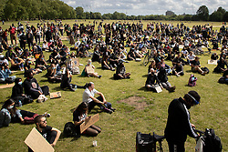 © Licensed to London News Pictures. 21/06/2020. London, UK. Black Lives matter protesters gather in Hyde park in Central London. Protests have taken place across the United States and in cities around the world in response to the killing of George Floyd by police officers in Minneapolis on 25 May. Photo credit: George Cracknell Wright/LNP