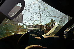 The remains of the destroyed Canal Hotel are seen through a shattered windshield in Baghdad, Iraq on Aug. 21, 2003. Earlier in the week a cement truck packed with explosives detonated outside the offices of the UN headquarters in Baghdad, Iraq, killing 20 people and devastating the facility in an unprecedented suicide attack against the world body. At least 100 people were wounded.