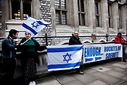 "London session of the Russel Tribunal on Palestine. "" Corporate Complicity in Israel's violations in international human rights law and international humanitarian law"". A small group of Zionists staging a protest demonstration outside the tribunal."