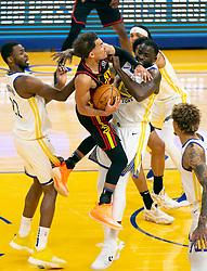 Mar 26, 2021; San Francisco, California, USA; Golden State Warriors forward Draymond Green (23) fouls Atlanta Hawks guard Trae Young (11) during the second quarter of an NBA basketball game at Chase Center. Mandatory Credit: D. Ross Cameron-USA TODAY Sports