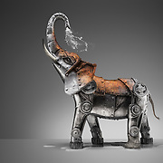 A metal elephant spraying itself with water and making itself rusty. A conceptual image created by photographer Stuart Freeman.