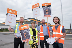 "© Licensed to London News Pictures. 22/07/2019; Bristol, UK. Members and activists from the GMB union in Bristol hold a protest at the end of the day shift at the giant Amazon ""Fulfilment"" distribution centre in Severn Beach, and hand out a body mapping survey to workers leaving the site for them to indicate if the work at Amazon is causing them pain. The union is not recognised by Amazon at the site, but the GMB have produced a report about Amazon and are concerned about health and safety at the centre and that there may be unsafe working practices. In 2018 the GMB conducted a health and safety survey of their members employed at Amazon Fulfilment distribution centres and 87% of respondents said their work caused them constant pain, and they also have information that over a three year period over 600 ambulances visited Amazon Fulfilment distribution centres. Photo credit: Simon Chapman/LNP."
