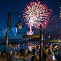 Fireworks explode over the Cape Fear River as spectators watch on the 4th of July.