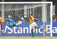 Photo: Steve Bond/Richard Lane Photography.<br /> Ivory Coast v Benin. Africa Cup of Nations. 25/01/2008. Keeper Rachad Chitou dives as the header of Aruna Dindane hits the post