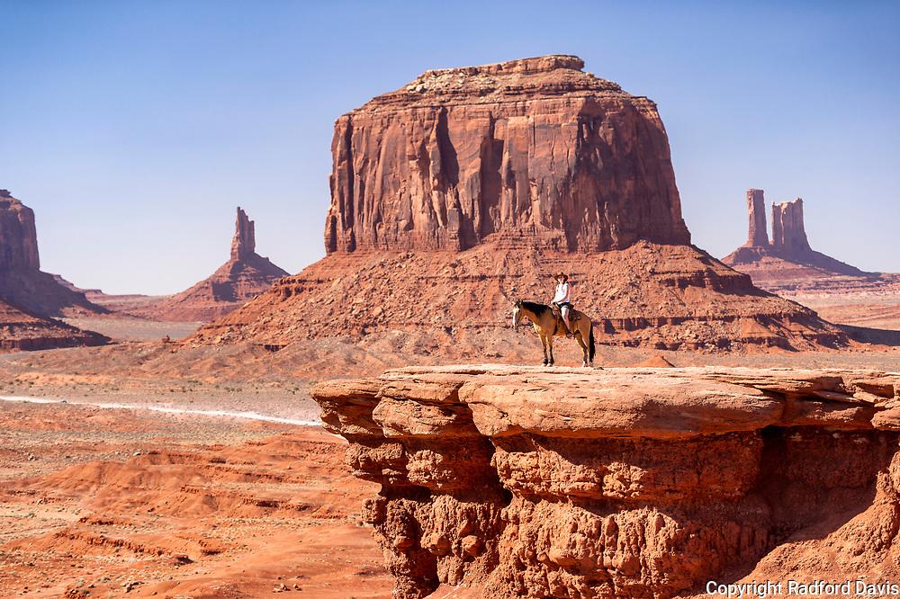 Woman on horseback, Monument Valley, Navajo Reservation. Arizona.