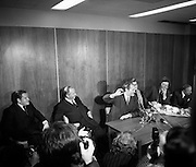 At a press conference before his return to Holland, Dr Herrema holds up the bullet given to him by his captor Eddie Gallagher, who told him: 'This was meant for you'. To his left (partly obscured) is his wife Elizabeth. 08/11/1975