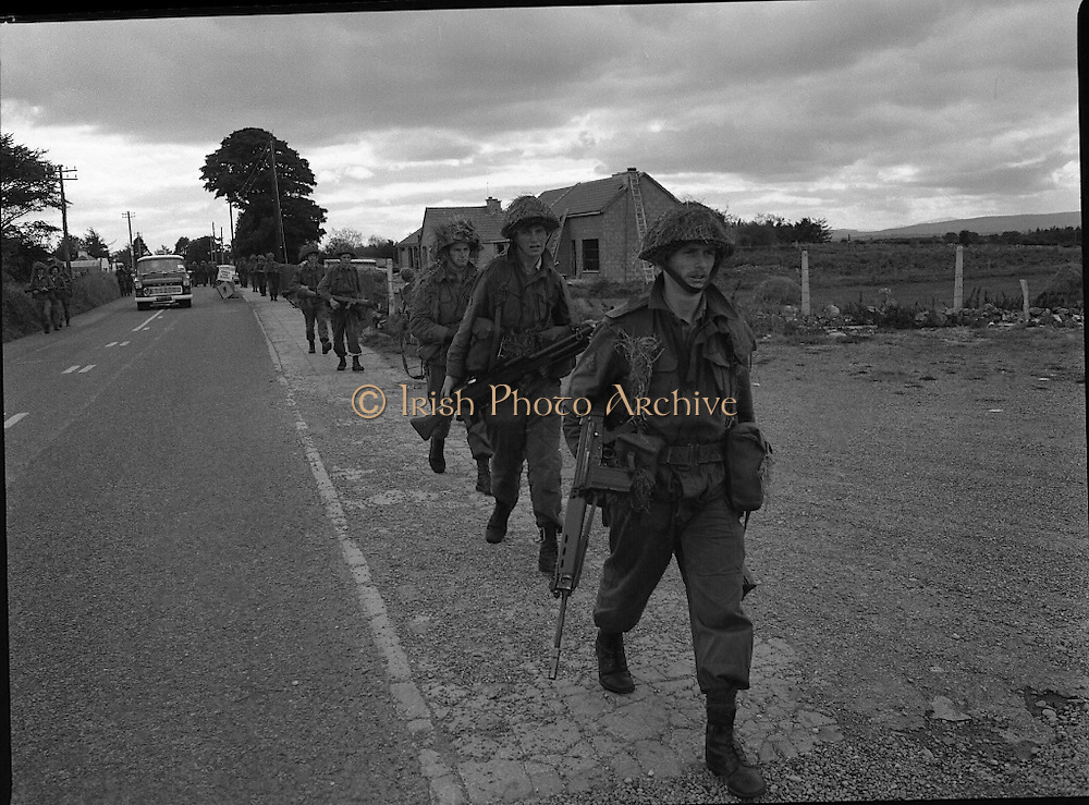 """Army Exercises In Co Sligo.   (L37).<br /> 1977.<br /> 05.09.1977.<br /> 09.05.1977.<br /> 5th September 1977.<br /> The Army Reserve Brigade, which is made up of regular units from the Southern Command, are conducting a series of conventional military exercises in counties Mayo and Sligo from the 5th to the 9th September. Approximately 1,500 men and 250 vehicles are involved. The exercise was codenamed """"Humbert"""" after an ill fated expedition by French troops into Ireland on 23rd August 1798. 1,100 French troops with Irish support took on the incumbent English forces. After some initial success they were defeated at Ballinamuk on 8th Sept 1798 by the army of Cornwallis.<br /> <br /> Picture shows some soldiers taking up position during the military exercises."""