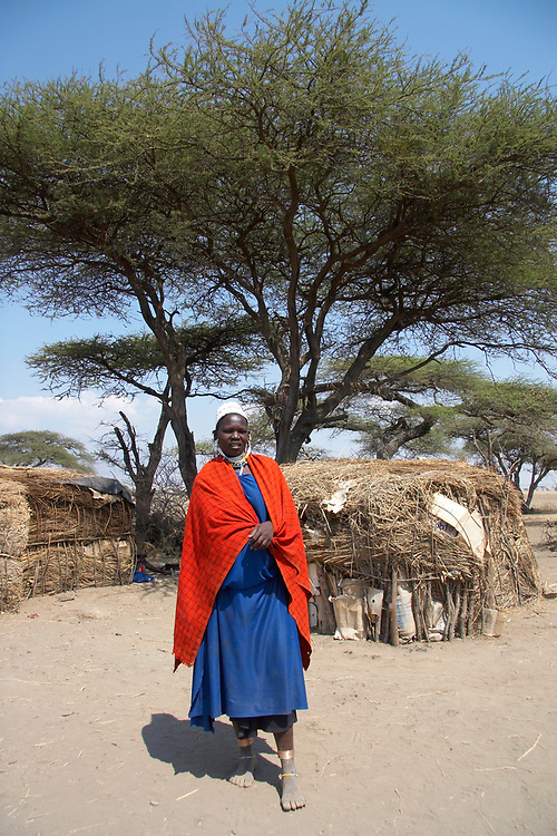 Maasai woman in front of her hut in the village near the Olduvai Gorge, Tanzania