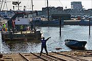 Nederland, Urk, 19-2-2015Een vissersboot ligt op de helling voor onderhoud en reparatie. Zicht op de haven van dit voormalig eiland. Foto: Flip Franssen/Hollandse Hoogte