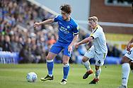 Peterborough midfielder Alex Woodyard and Burton Albion midfielder Jamie Allen (4) during the EFL Sky Bet League 1 match between Peterborough United and Burton Albion at London Road, Peterborough, England on 4 May 2019.