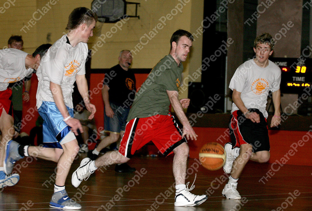 07.04.12<br /> 20th Annual Frank Gallery Memorial Basketball Tournament. Action from the final between Sluagh Hall Suns and the Scout Hall Skins. Sluagh Hall Suns Cathal McInerney in action against Scout Hall Skins, Tommy Kinch and Kevin Falvey.Pic: Alan Place Press 22