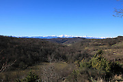 landscape view with snow capped Pyrenees mountain range in the distance seen from France Aude