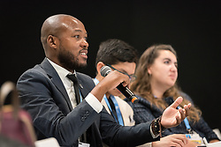 4 December 2019, Madrid, Spain: Lutheran World Federation delegate and council member Khulekani Sizwe Magwaza from the Evangelical Lutheran Church in South Africa asks a question at a press conference held at COP25, reporting on the findings of an interfaith dialogue on 1 December.