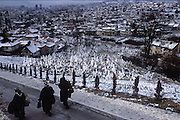 Signs of the four-year siege of Sarajevo are still obvious today. Cemeteries such as this one in the Muslim quarter back right up to the residential neighborhoods nearby. Sarajevo, Bosnia and Herzegovina. (Supporting image from the project Hungry Planet: What the World Eats.)