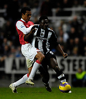 Photo: Jed Wee/Sportsbeat Images.<br /> Newcastle United v Arsenal. The FA Barclays Premiership. 05/12/2007.<br /> <br /> Newcastle's Obafemi Martins (R) is tackled by Arsenal's Gilberto Silva.