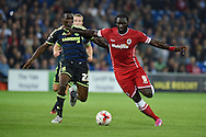 Kenwyne Jones of Cardiff city ® holds off Middlesbrough's Kenneth Omeruo. Skybet football league championship match, Cardiff city v Middlesbrough at the Cardiff city stadium in Cardiff, South Wales on Tuesday 16th Sept 2014<br /> pic by Andrew Orchard, Andrew Orchard sports photography.