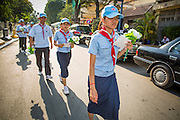 """04 FEBRUARY 2013 - PHNOM PENH, CAMBODIA: Cambodian Boy and Girl Scouts walk to the National Museum for the cremation of King-Father Norodom Sihanouk to begin. Norodom Sihanouk (31 October 1922- 15 October 2012) was the King of Cambodia from 1941 to 1955 and again from 1993 to 2004. He was the effective ruler of Cambodia from 1953 to 1970. After his second abdication in 2004, he was given the honorific of """"The King-Father of Cambodia."""" Sihanouk died in Beijing, China, where he was receiving medical care, on Oct. 15, 2012.    PHOTO BY JACK KURTZ"""