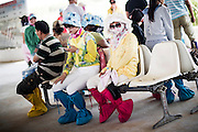Chinese tourists sit on a bench in the shadow as they wear scarfs and hats to protect themselves from the sun of the Gobi Desert in Inner Mongolia, China, July 27, 2014. <br /> <br /> Pale skin has historically been prized as beautiful in China, and the concept is widespread in other Asian countries. Besides health topics, beauty is one of the main reasons that makes protection from the sun's rays so important. <br /> <br /> © Giorgio Perottino