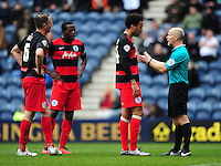 Referee Andy Woolmer speaks to Queens Park Rangers' James Perch as Queens Park Rangers' Clint Hill, left, and Queens Park Rangers' Nedum Onuoha, second from left, attempt to join the conversation<br /> <br /> Photographer Chris Vaughan/CameraSport<br /> <br /> Football - The Football League Sky Bet Championship - Preston North End v Queens Park Rangers - Saturday 19th March 2016 - Deepdale - Preston <br /> <br /> © CameraSport - 43 Linden Ave. Countesthorpe. Leicester. England. LE8 5PG - Tel: +44 (0) 116 277 4147 - admin@camerasport.com - www.camerasport.com