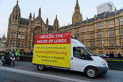 © Licensed to London News Pictures.07/03/2017.London, UK. A van carrying an advertisement calling for the abolition of the House Of Lords, drives past Parliament on the day of a vote in the Lord's on the third reading of the Brexit bill. .Photo credit: Ben Cawthra/LNP