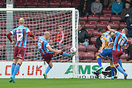 David Mirfin of Scunthorpe United kicks towards goal during the Sky Bet League 1 match between Scunthorpe United and Shrewsbury Town at Glanford Park, Scunthorpe, England on 17 October 2015. Photo by Ian Lyall.