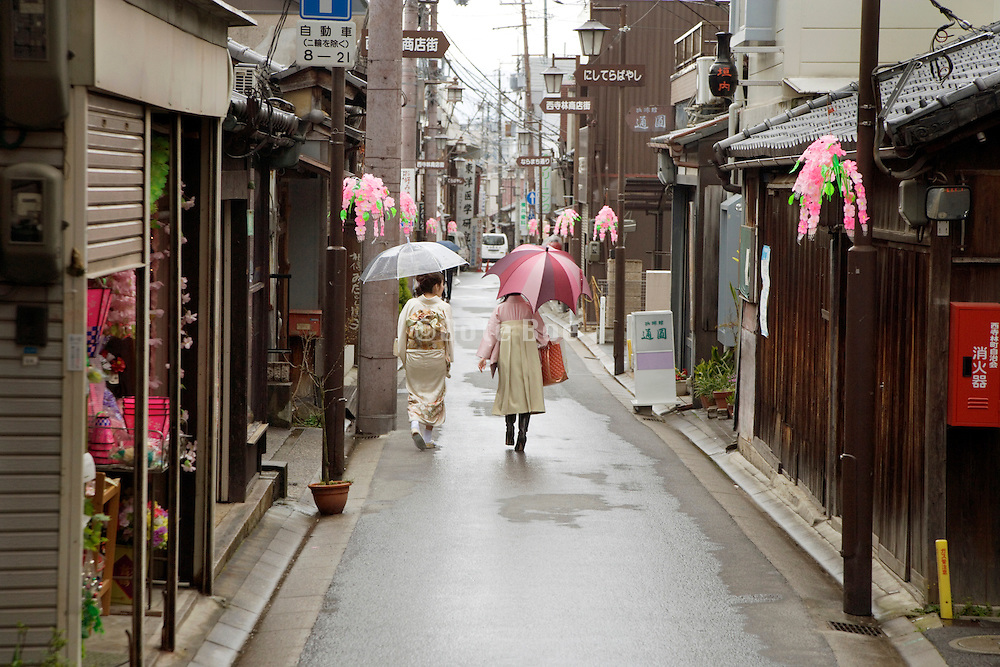 young girls in traditional Japanese dress walking in old Nara