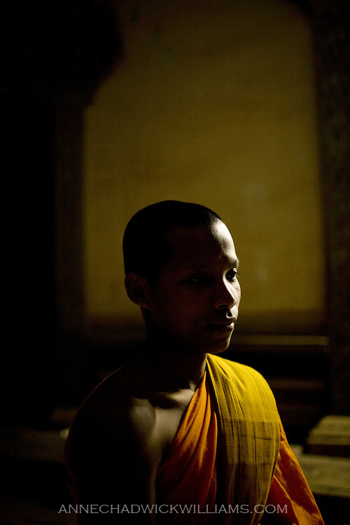 Cambodian monk in prayer before evening service.