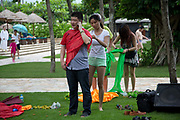 Participants of Diamond Love, a high-end dating service, take part in games in Sanya, Hainan Province,  China on15 June  2013.  Male participants of the dating service pay up to 20,000 USD to attend such events in hopes of finding a suitable match while most of the women are selected by the match making service according to their looks, education, and personality.