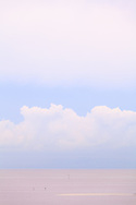 Gently contrasting stacked layers of cloud, open sky, horizon and water on Biscayne Bay near Miami, Florida. WATERMARKS WILL NOT APPEAR ON PRINTS OR LICENSED IMAGES.