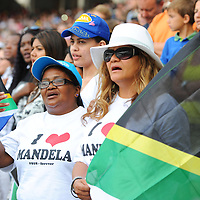 """Members of the crowd sing the South African national anthem during the City of Cape Town hosted concert at the 45000 seater Cape Town Stadium called """"Nelson Mandela - A life Celebrated"""". Nelson Mandela was the first democratically elected president of South Africa."""
