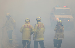 November 11, 2019, New South Wales, Australia: Firefighters take a break in smoke while battling bushfires near Taree, New South Wales. A devastating start to the Australian bushfire season has prompted a state of emergency in the eastern state of New South Wales (NSW), with the country's largest city, Sydney bracing for ''catastrophic'' fire danger. On Monday, a state of emergency was declared for NSW, with exceptionally hot and windy conditions predicted for Tuesday, threatening to create an even bigger fire disaster than that which left three people dead last week. (Credit Image: © Bai Xuefei/Xinhua via ZUMA Wire)