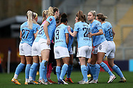 Manchester City huddle during the FA Women's Super League match between Manchester United Women and Manchester City Women at Leigh Sports Village, Leigh, United Kingdom on 14 November 2020.
