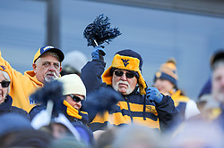 Nov 10, 2018; Morgantown, WV, USA; A West Virginia Mountaineers fan cheers during the third quarter against the TCU Horned Frogs at Mountaineer Field at Milan Puskar Stadium. Mandatory Credit: Ben Queen-USA TODAY Sports